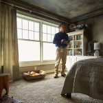 Fire & Smoke Damage Restoration – Rochester, NH - a ServiceMaster tech examining a room with fire damage