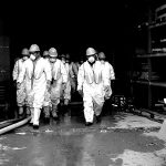 Specialty Cleaning Services – Rochester, NH: men in hazmat suits walking out of a dark corridor