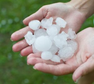 Hail from a thunderstorm - water damage restoration by ServiceMaster Disaster Associates