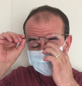 Disinfection Cleaning in Stoneham MA and NH by ServiceMaster Disaster Associates, Inc. - man with face mask rubbing his eye